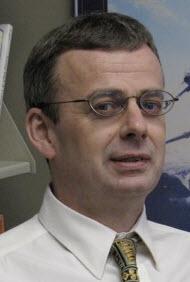 Dr. Angus Menuge