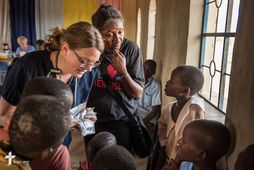 Shara Cunningham, career missionary in Eastern and Southern Africa, and Sarah Kanoy, an career missionary in East Africa, treat patients at the LCMS Mercy Medical Team on Monday, June 20, 2016, in Nataparkakono, a village in Turkana, Kenya. LCMS Communications/Erik M. Lunsford