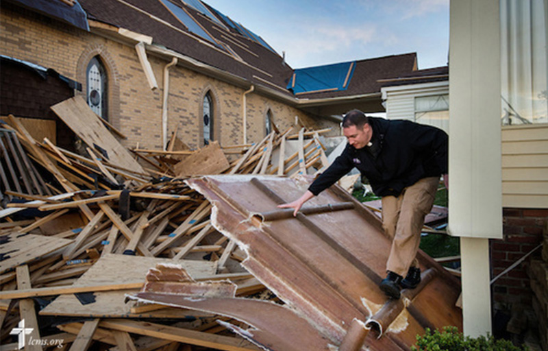 The Rev. Michael Meyer, manager of LCMS Disaster Response, climbs through debris Thursday, May 1, 2014, at Holy Trinity Lutheran Church in Tupelo, Miss. The church suffered catastrophic damage caused by a tornado earlier in the week. LCMS Communications/Erik M. Lunsford