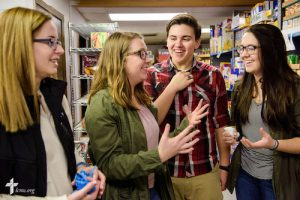 Sarah Franklin (left) and Isabella Schneider (center) talk with Jacob Welch and Emma Tharp, all of Immanuel Lutheran Church & School in St. Charles, Mo., after they delivered food pantry items on Sunday, Feb. 26, 2017, to Oasis Food Pantry in St. Charles. LCMS Communications/Erik M. LunsfordLCMS Communications/Erik M. Lunsford