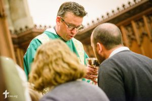 The Rev. Eric R. Andræ distributes the sacrament during worship at First Trinity Evangelical–Lutheran Church on Sunday, Nov. 20, 2016, in Pittsburgh. LCMS Communications/Erik M. Lunsford
