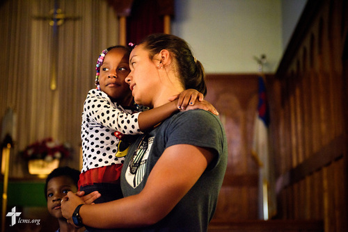 Kristin Boos carries Taniya Wimberly at the end of vacation Bible camp at East Bethlehem Lutheran Church, Detroit, Mich., on Wednesday, June 21, 2017, in Detroit. LCMS Communications/Erik M. Lunsford