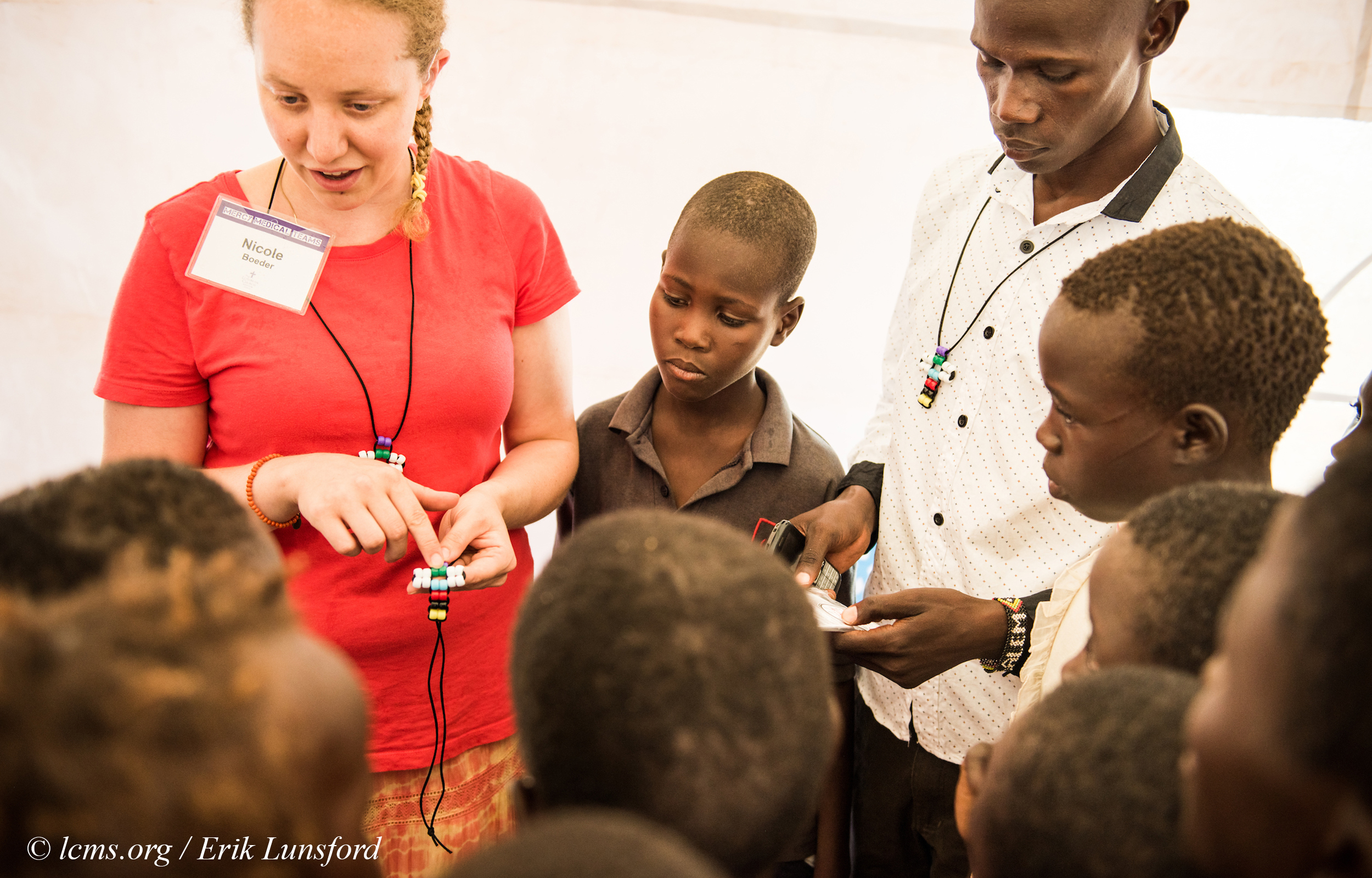 Nicole Boeder, a teacher and a member of Trinity Lutheran Church, Springfield, Ill., witnesses to children about Jesus during the LCMS Mercy Medical Team on Tuesday, June 21, 2016, in Nataparkakono, a village in Turkana, Kenya. LCMS Communications/Erik M. Lunsford