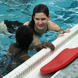LHSS student instructs a swim lesson.