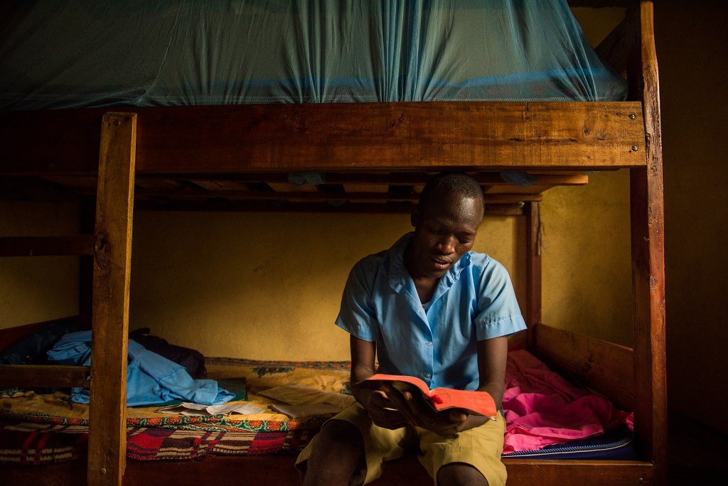 Moses Rutale studies the Book of Luke in his dormitory as he prepares to lead the other Udom students in the evening devotion. LCMS COMMUNICATIONS / Erik Lunsford