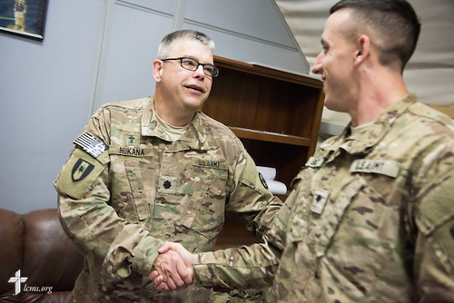 Army Lt. Col Steven Hokana, chaplain, visits a soldier at Camp Arifjan on Tuesday, March 24, 2015, in Kuwait. LCMS Communications/Erik M. Lunsford