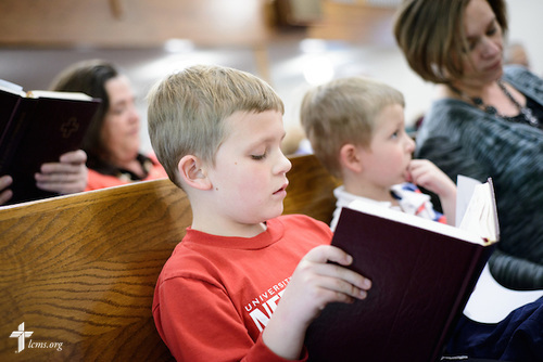 Joshua Nierman, son of the Rev. Mark Nierman, pastor of Mount Olive Lutheran Church, sings with his family during Lenten worship on Wednesday, March 2, 2016, in Loveland, Colo. LCMS Communications/Erik M. Lunsford
