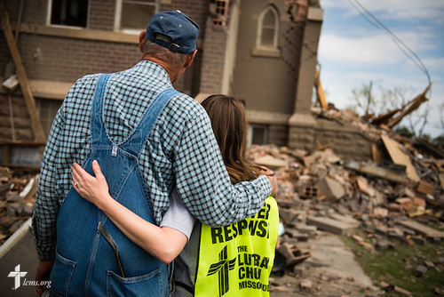 Glennis Stern hugs Jennifer Bucklew, the spouse of the Rev. Brian Bucklew, pastor at Zion Lutheran Church, as they reflect on the damage to their church on Tuesday, May 12, 2015, in Delmont, S.D. A tornado swept through the area on Sunday and destroyed Zion along with nearby buildings. LCMS Communications/Erik M. Lunsford