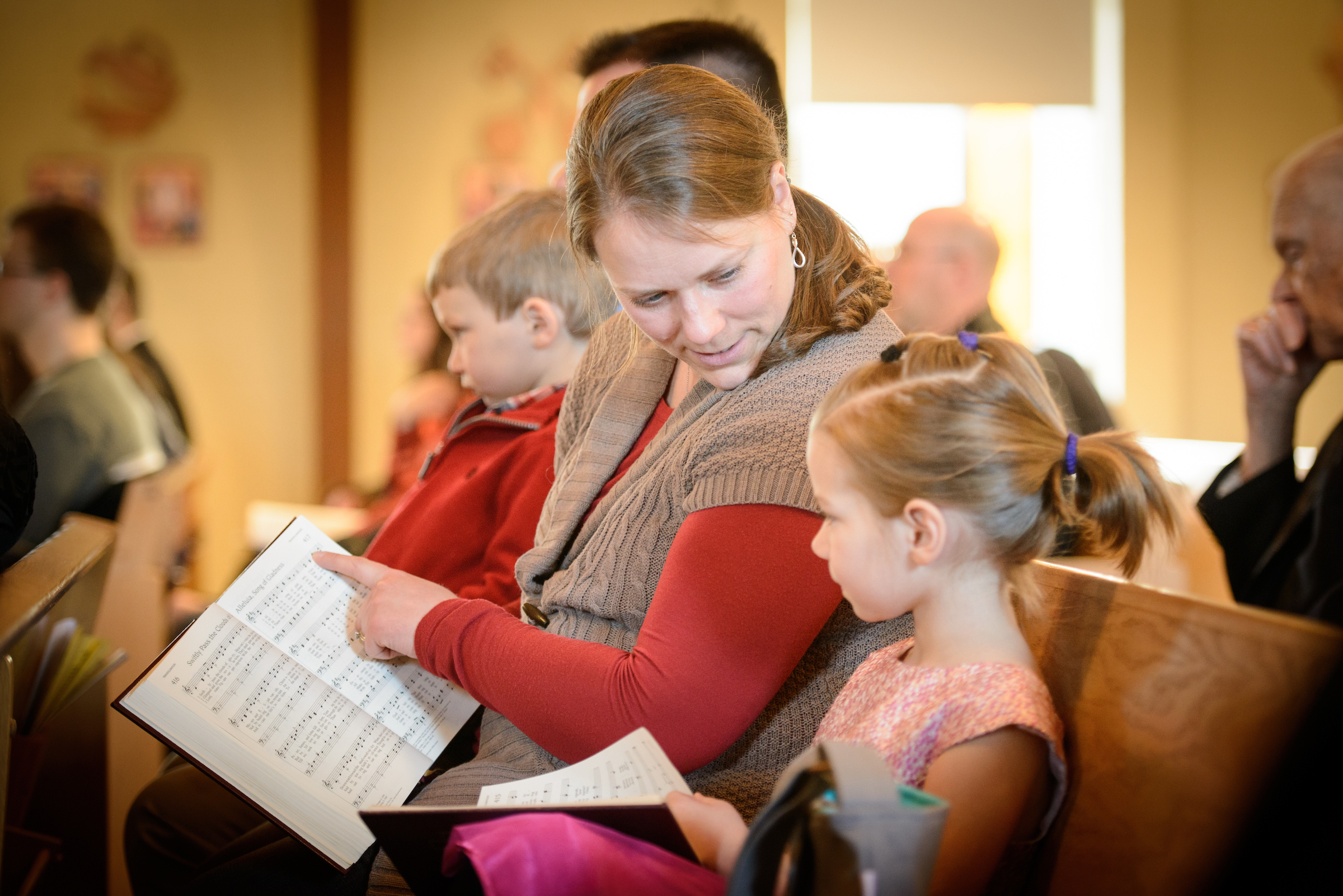 Laurie Vogt leads her daughter Abigail Vogt in the Lutheran Service Book during worship on Transfiguration Sunday, Feb. 7, 2016, at Peace Lutheran Church in Sussex, Wis., LCMS Communications/Erik M. Lunsford