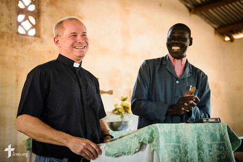 The Rev. Gary Schulte, area director for West and Central Africa, greets church members following the Lutheran Church of Togo in Mire on Sunday, Feb. 12, 2017, in Mire, Togo. He is joined by the Rev. Lare Kolani Lambon, president of the Lutheran Church of Togo. LCMS Communications/Erik M. Lunsford