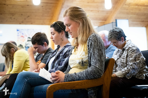 Young Adult Corps participants Courtney Haag (center), Madison Ezzell, and Hayden Duncan, pray together during evening worship on Wednesday, April 4, 2018, at Prince of Peace Lutheran Church, New Orleans. LCMS Communications/Erik M. Lunsford