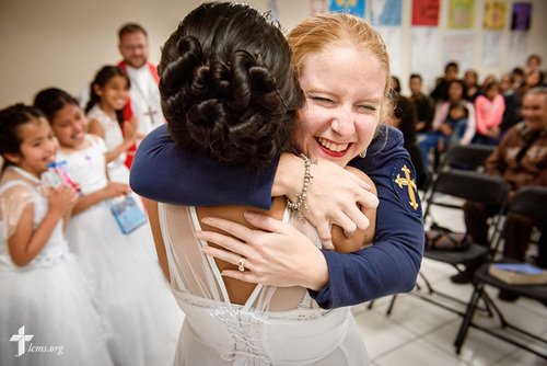 Naomi, a newly confirmed member, lifts up Deaconess Caitlin Worden de Ramírez, LCMS career missionary to Peru, in a joyful hug following a worship service with confirmations at Castillo Fuerte on Saturday, Nov. 4, 2017, in the La Victoria district of Lima, Peru. Ramirez is a big part of Naomi and her fellow confirmands' lives. LCMS Communications/Erik M. Lunsford