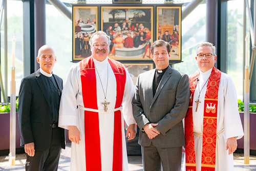 Group portrait of (L-R) the Rev. Steven Briel, chairman of the LCMS Board of National Mission, the Rev. Dr. Matthew C. Harrison, president of the LCMS, the Rev. Robert Zagore, executive director in the LCMS Office of National Mission, and the Rev. Kevin D. Robson, chief mission officer of the LCMS, in the chapel of the International Center of The Lutheran Church–Missouri Synod on Wednesday, May 30, 2018, in St. Louis. LCMS Communications/Erik M. Lunsford