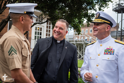 Chaplain Craig G. Muehler, director of Ministry to the Armed Forces, and Chaplain Gregory N. Todd, Rear Admiral (Lower Half), Chaplain Corps, United States Navy, greet a fellow Marine following Todd's promotion ceremony on Thursday, June 21, 2018, at Marine Barracks Washington, D.C. LCMS Communications/Erik M. Lunsford