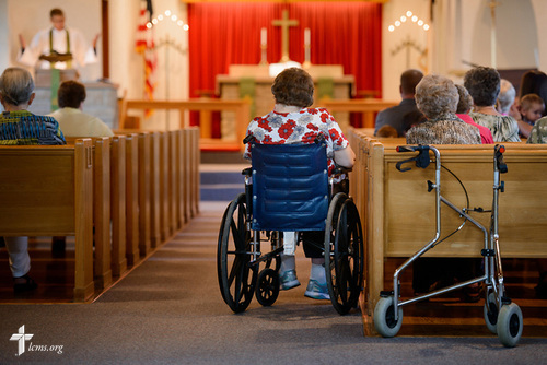 Jennifer Stripling listens as the Rev. Steven Struecker, full-time farmer and pastor of Immanuel Lutheran Church, Livermore, Iowa, and Zion Evangelical Lutheran Church, Lu Verne, Iowa, preaches at the church in Livermore on Sunday, July 9, 2017. LCMS Communications/Erik M. Lunsford