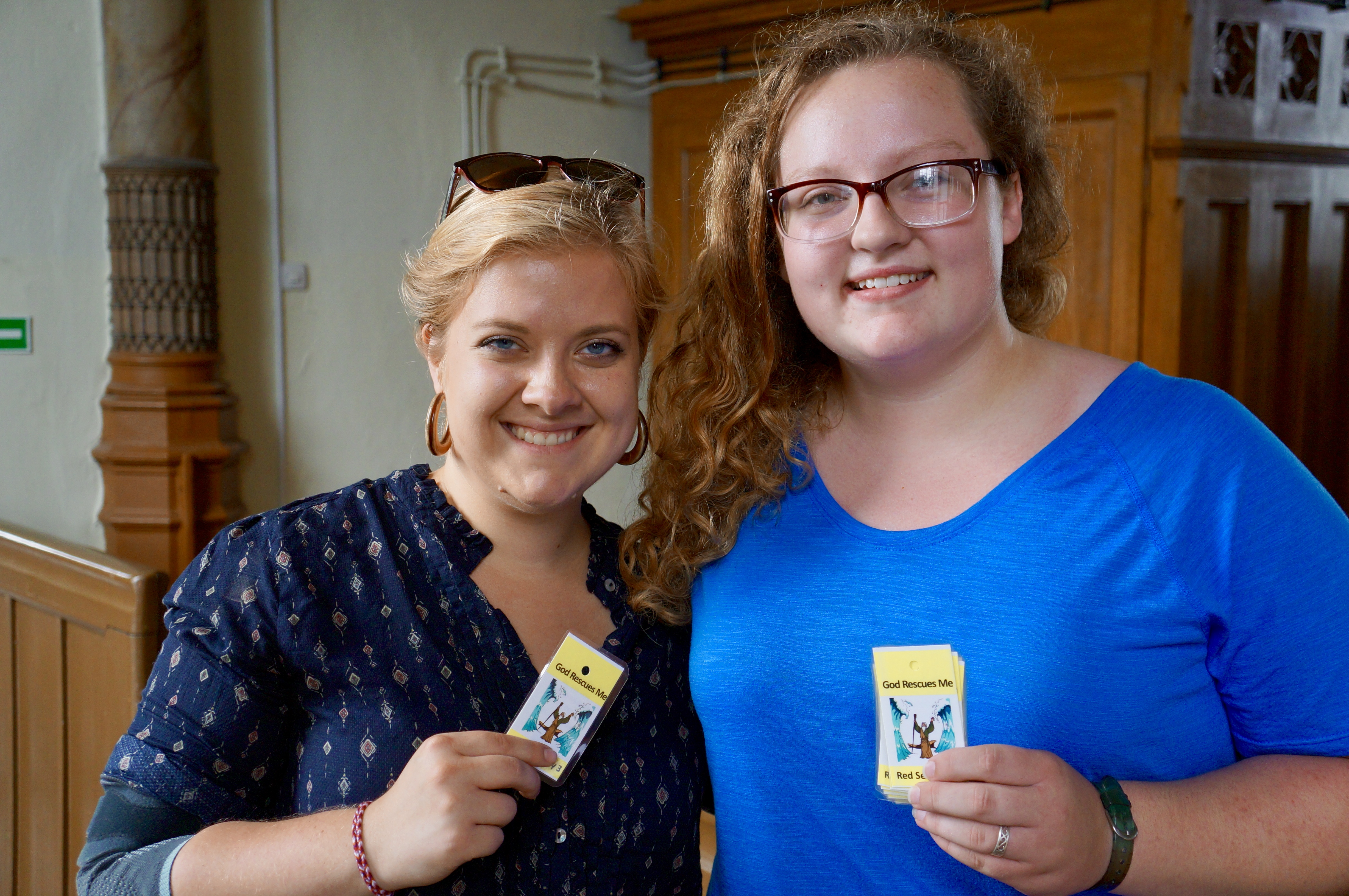 "Photo: GEO Missionary Sarah Harms and a teen from Immanuel Lutheran Church in Broken Arrow, OK, hold up the ""take home"" cards for the day of ""God Rescues Me"" at an Engligh Bible Camp in Poland. LCMS/Benjamin Helge Used with permission."