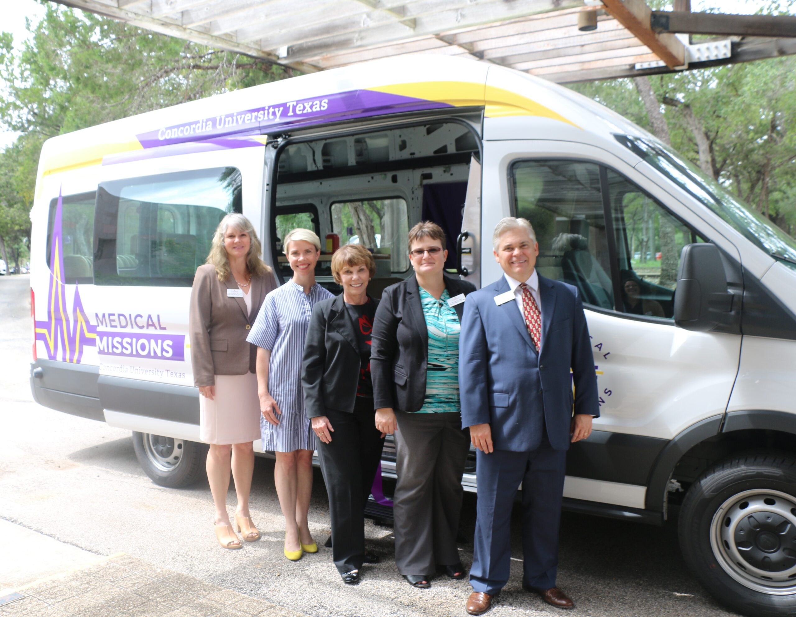 Concordia Texas representatives stand in front of the new Mobile Medical Missions van to be used with CTX's nursing program. Used with permission