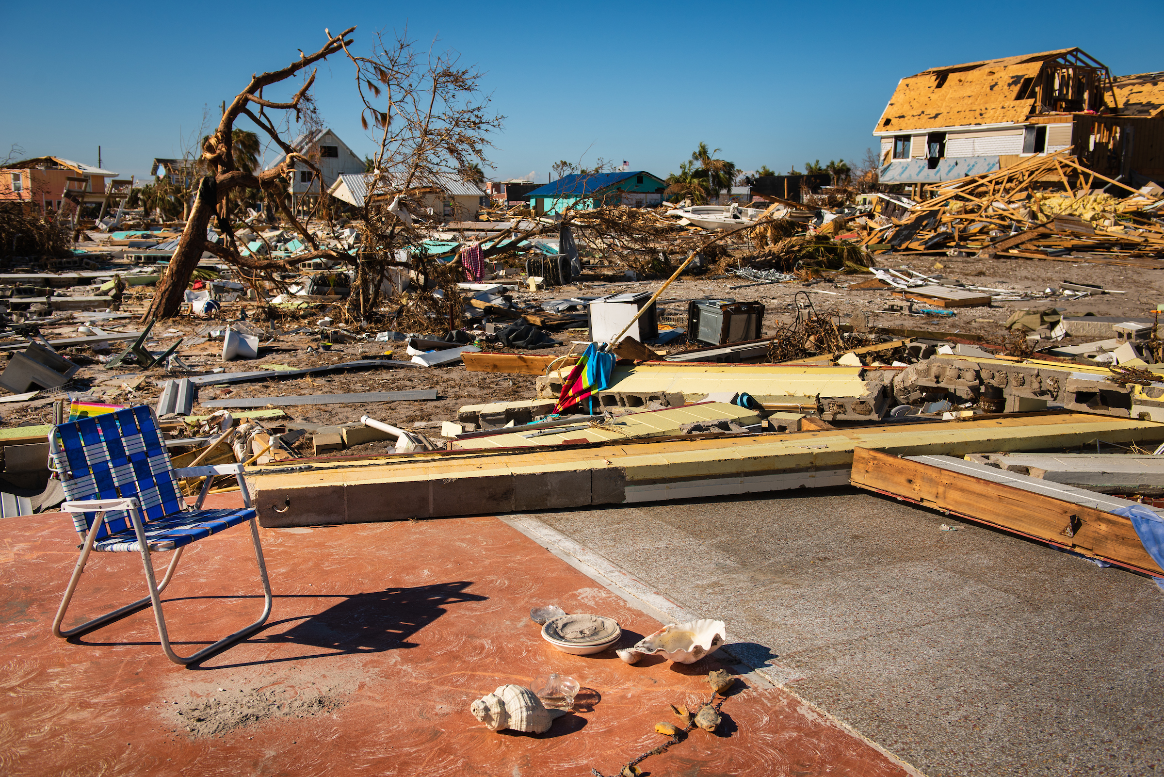 A lawn chair on a foundation where a home once stood on Tuesday, Oct. 16, 2018, in Mexico Beach, Fla. Hurricane Michael devastated the area the previous week. LCMS Communications/Erik M. Lunsford