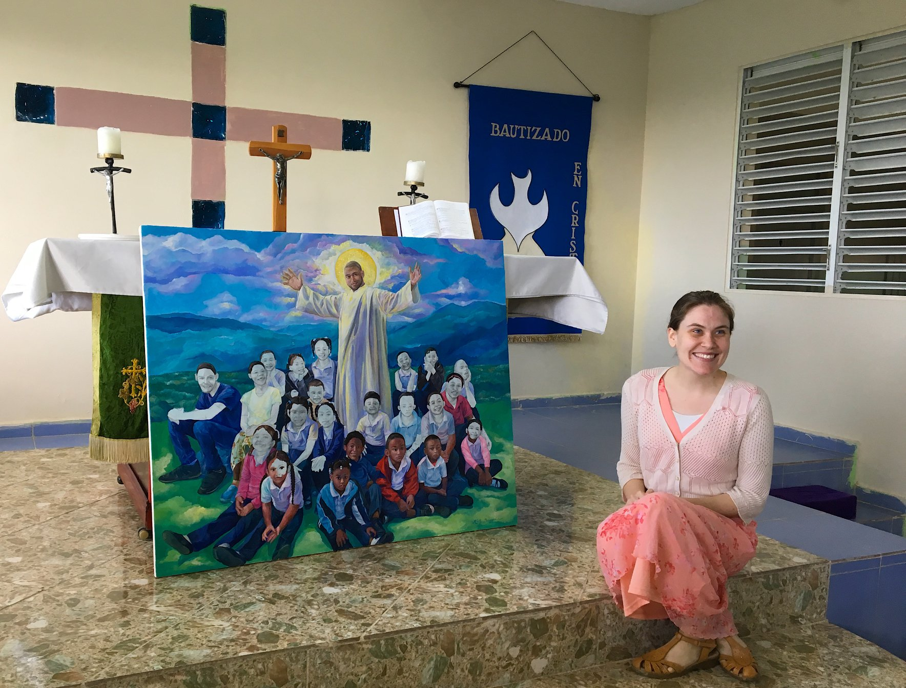 "Kelly Schumacher and her painting ""Jesus and the Children"""
