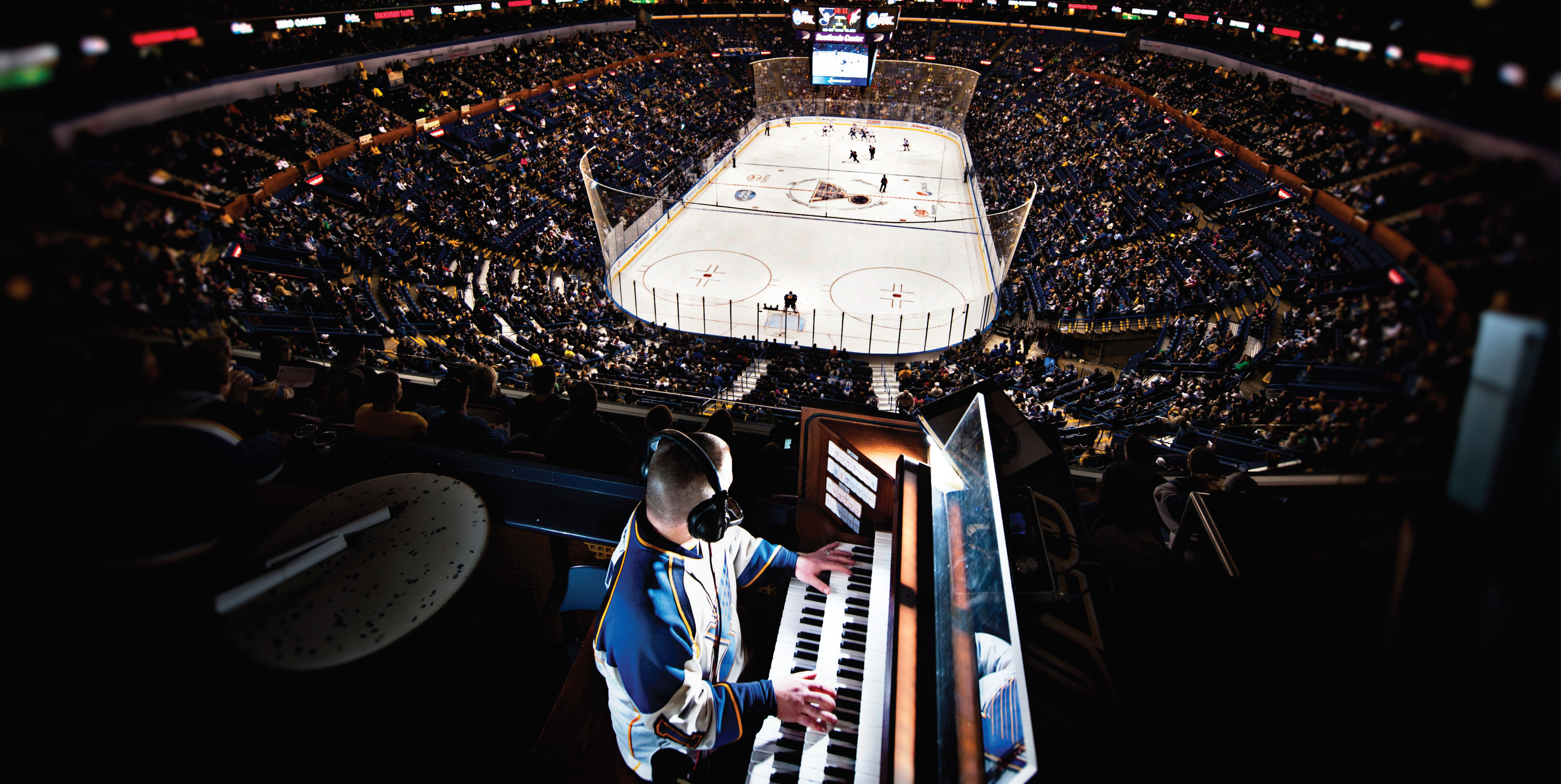 Jeremy Boyer, organist for the St. Louis Blues, watches a play during a Blues game. Used with permission.