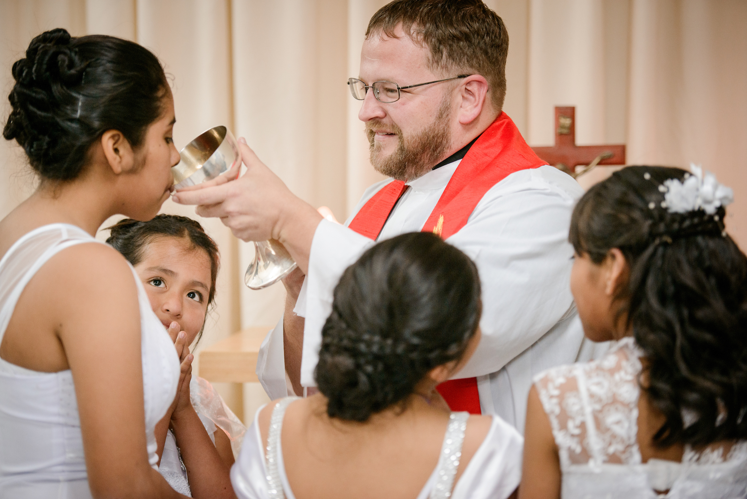 The Rev. Eddie Hosch, LCMS career missionary to Peru, distributes the Sacrament for the first time to new confirmand Naomi at Castillo Fuerte on Saturday, Nov. 4, 2017, in the La Victoria district of Lima, Peru. LCMS Communications/Erik M. Lunsford