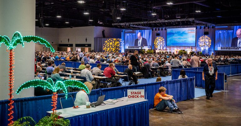 One of the pages (in orange) serving at the 67th Regular Convention of The Lutheran Church—Missouri Synod (LCMS) rests outside the delegate area on July 23 as elections for Synod boards take place on the convention floor. (LCMS/Erik M. Lunsford)