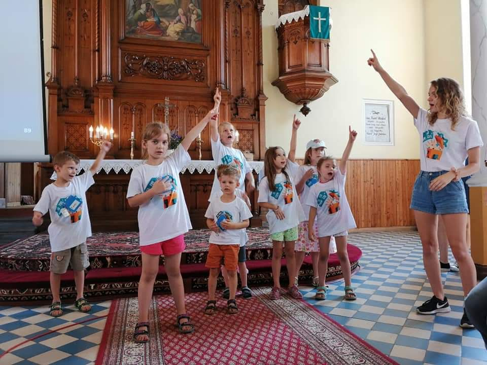 Katie Scherger, Short-term volunteer for the English Bible Camp in Konin, Poland, in August 2019, sings songs with campers.