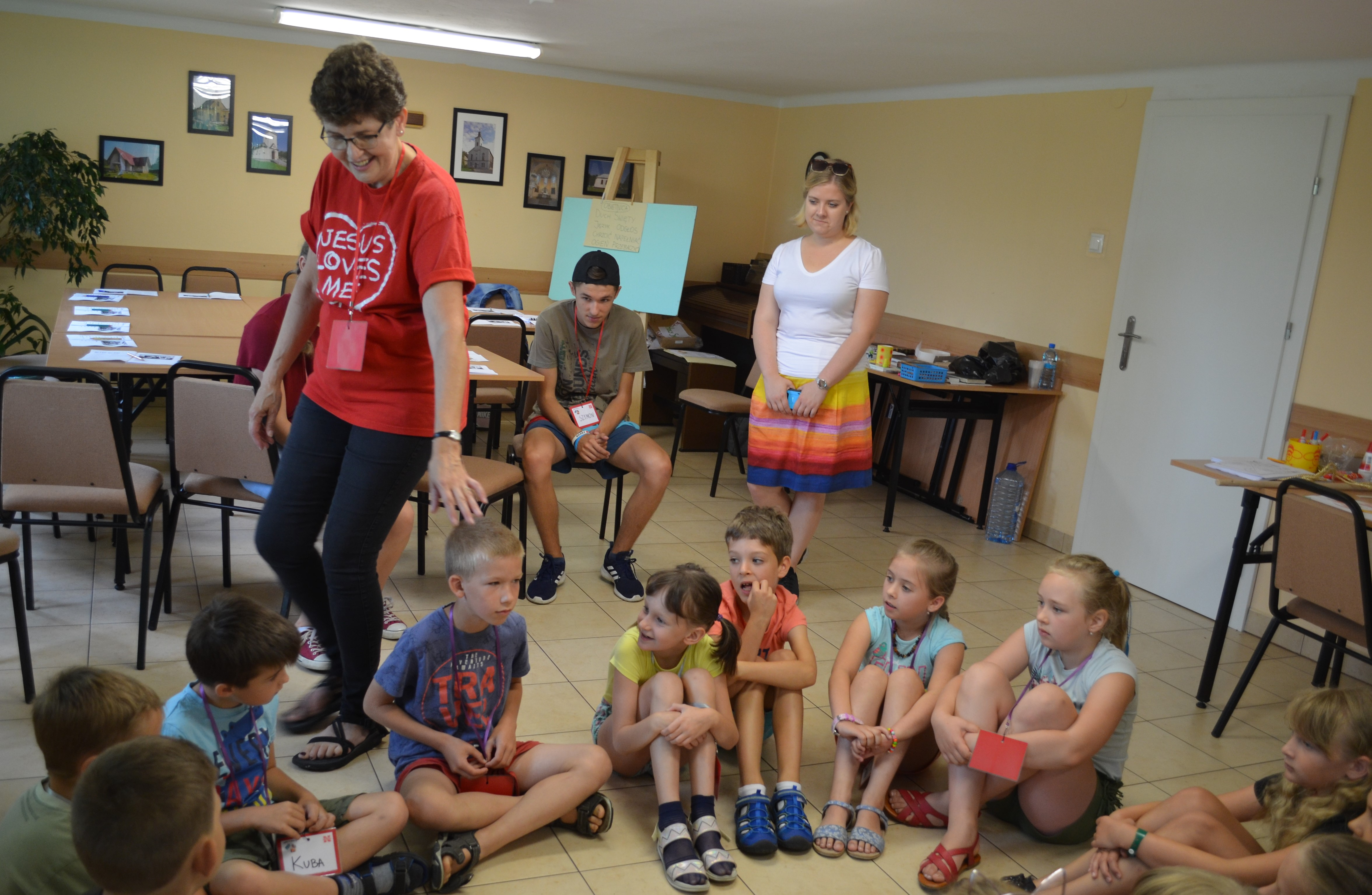 Joyce Kroll, volunteer for English Bible Camp in Poland, teaches her student.