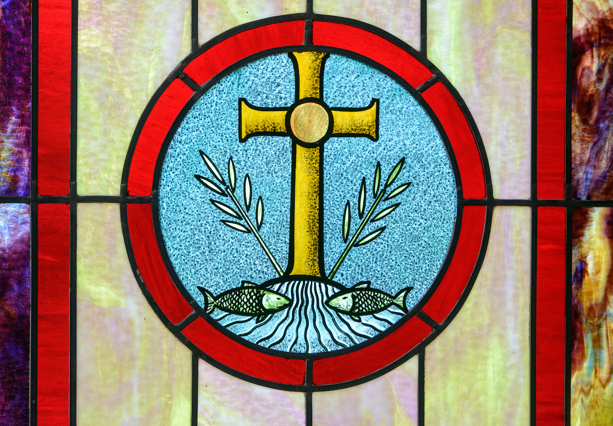 Stained glass depicting the cross at Zion Evangelical Lutheran Church, Lu Verne, Iowa, on Sunday, July 9, 2017. LCMS Communications/Erik M. Lunsford